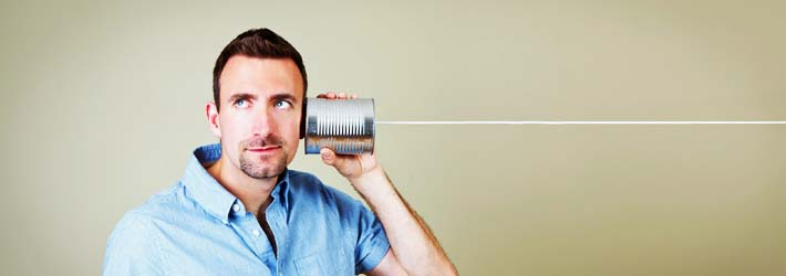 man-talking-on-tin-can-phone[1]